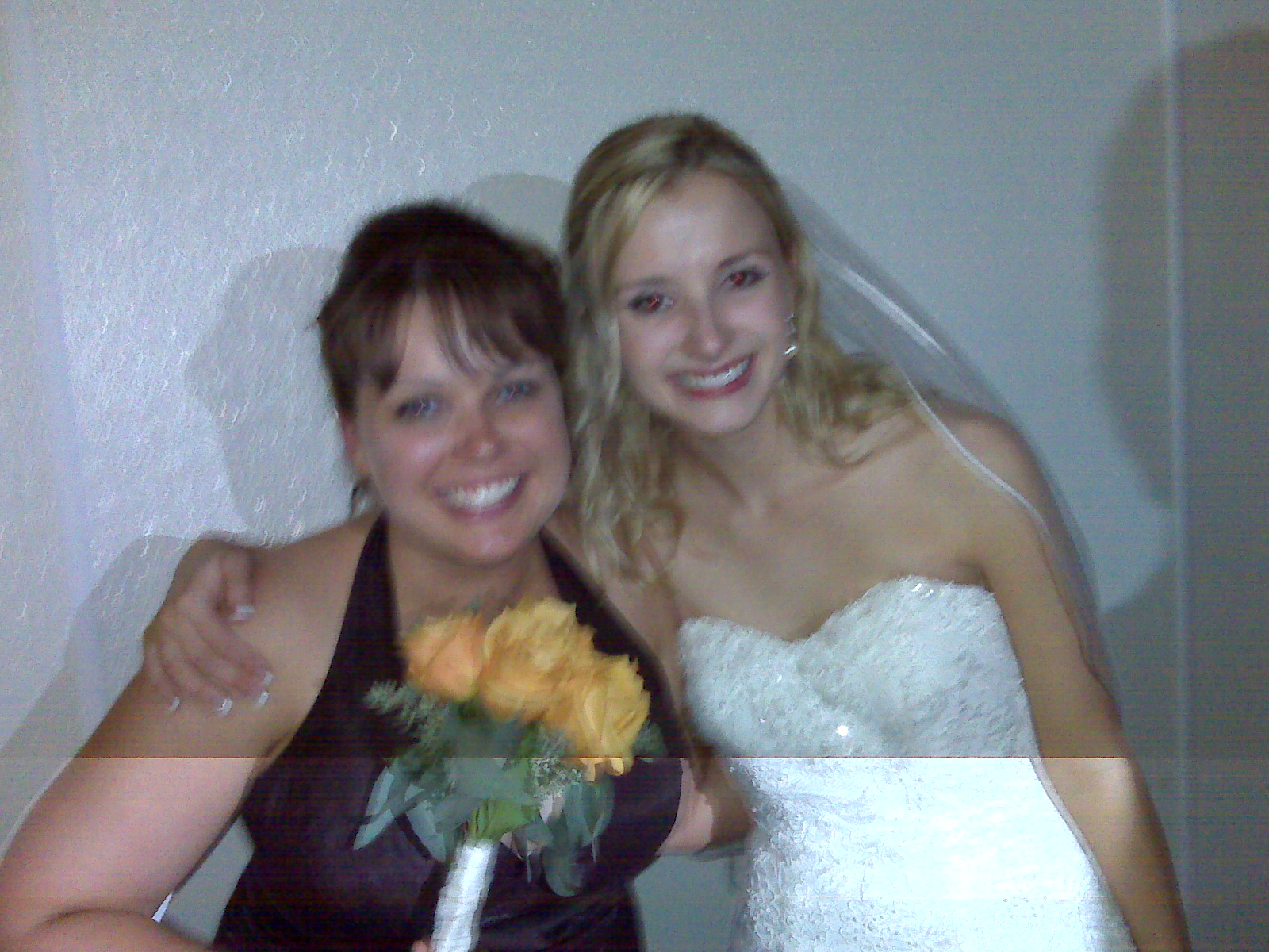 me, the bride, and carefully held flowers.